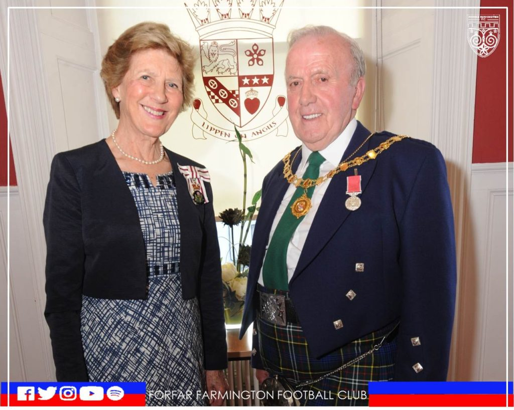 Colin Brown receiving his medal